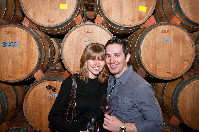 "Sammi and I in Ridge Lytton Spring's barrel room. I wanted a photo with all the ""Ridge"" barrels behind us.   Note, I see 2 different wines behind me: 1) 10ZNPZ for the 2010, Zinfandel, Ponzo 2) 10ZNLS for the 2010, Zinfandel, Lytton Springs"