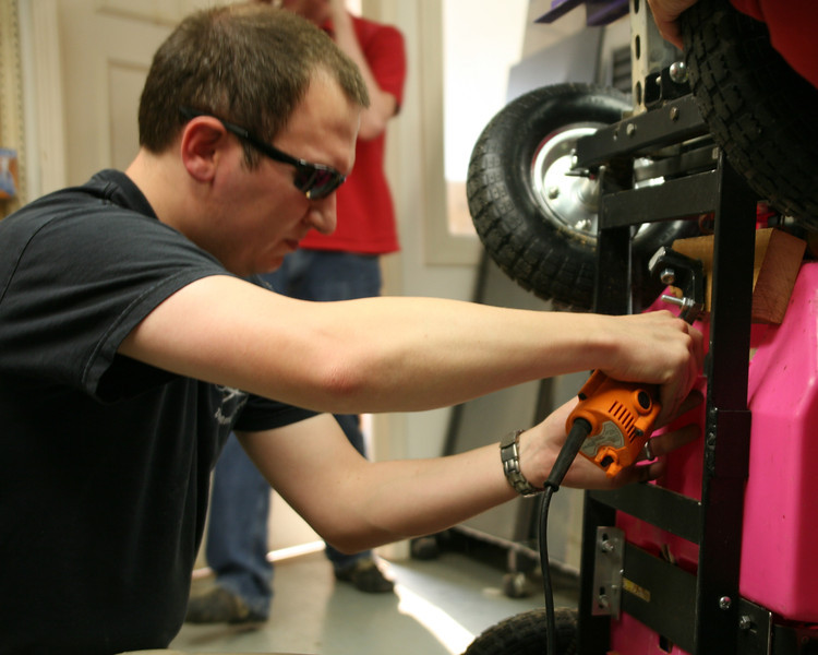 Kevin Fusselman does some fine tuning to the Jeep steering.