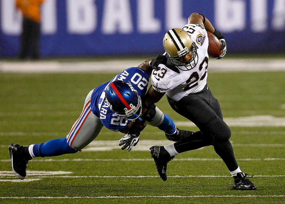 Description of . Prince Amukamara #20 of the New York Giants tackles Pierre Thomas #23 of the New Orleans Saints during their game at MetLife Stadium on December 9, 2012 in East Rutherford, New Jersey.  (Photo by Jeff Zelevansky/Getty Images)