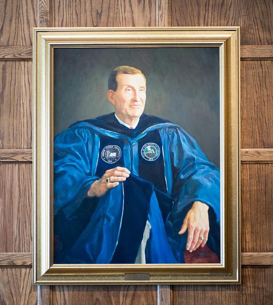 John Moore president portrait in Heritage Lounge