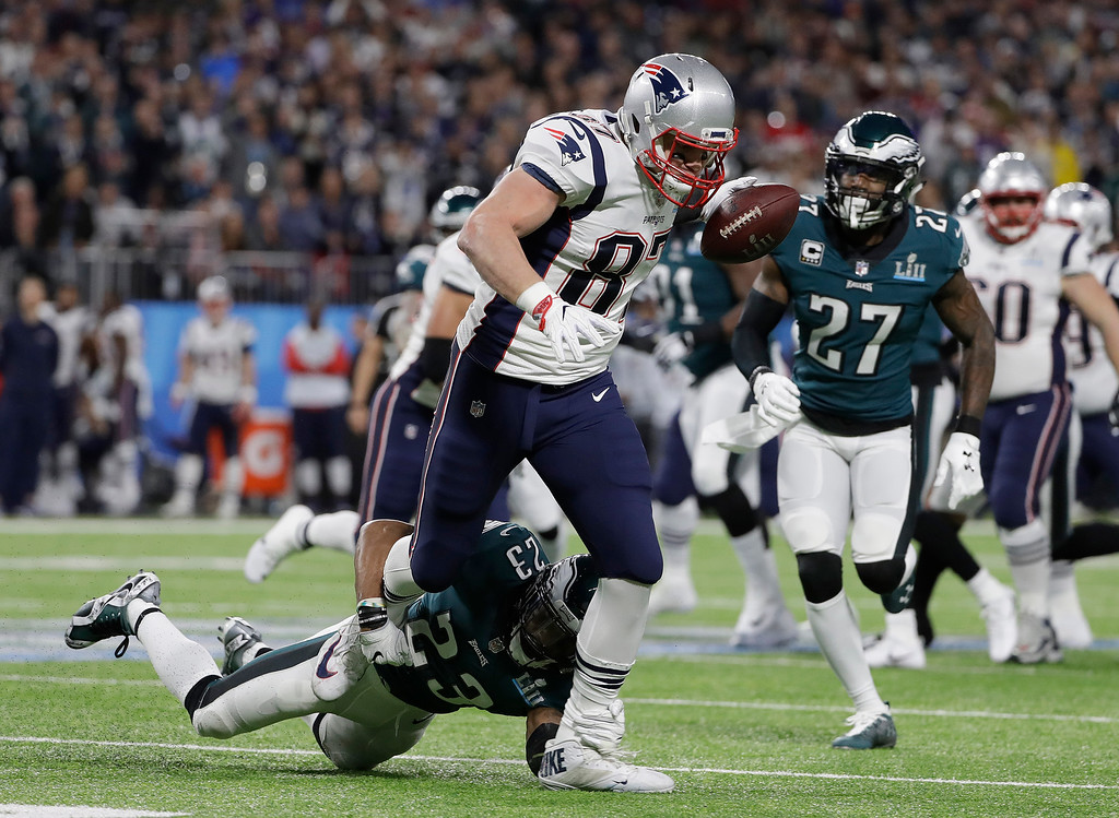 . Philadelphia Eagles\' Rodney McLeod, bottom, stops New England Patriots\' Rob Gronkowski (87) after a catch during the first half of the NFL Super Bowl 52 football game Sunday, Feb. 4, 2018, in Minneapolis. (AP Photo/Matt Slocum)