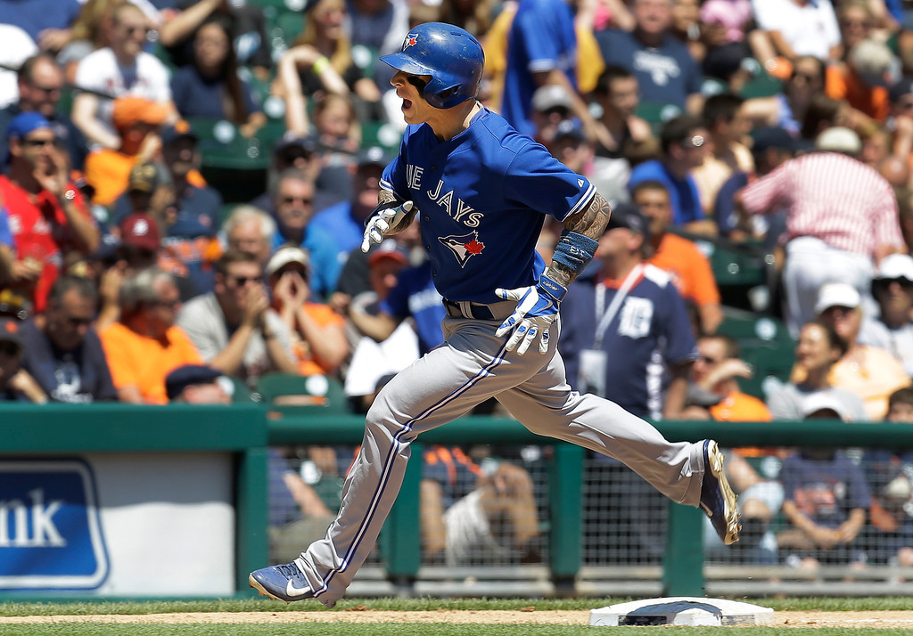 . Toronto Blue Jays\' Brett Lawrie rounds third base after hitting a solo home run against Detroit Tigers pitcher Justin Verlander  in the sixth inning of a baseball game in Detroit, Thursday, June 5, 2014. (AP Photo/Paul Sancya)