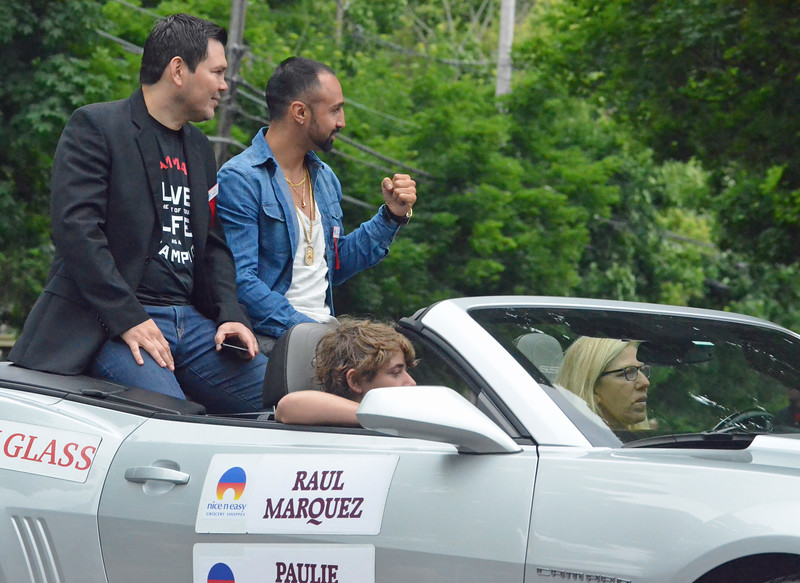 KYLE MENNIG - ONEIDA DAILY DISPATCH Raul Marquez gestures to the crowd as Paulie Malignalli looks on during the International Boxing Hall of Fame Induction Weekend Parade of Champions in Canastota on Sunday, June 12, 2016.