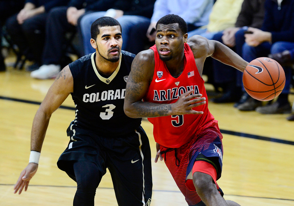 . Arizona guard Kadeem Allen drives on Colorado\'s Xavier Talton during the first half of an NCAA college basketball game Wednesday, Feb. 24, 2016, in Boulder, Coio. (AP Photo/Cliff Grassmick)