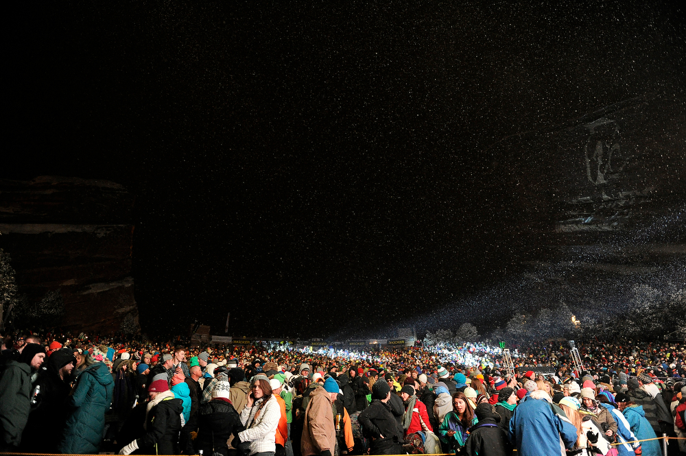 . Snow falls over Red Rocks Amphitheatre as fans wait for Jurassic 5 to perform during Winter on the Rocks on January 31, 2014 in Morrison, Colorado. (Photo by Seth McConnell/The Denver Post)