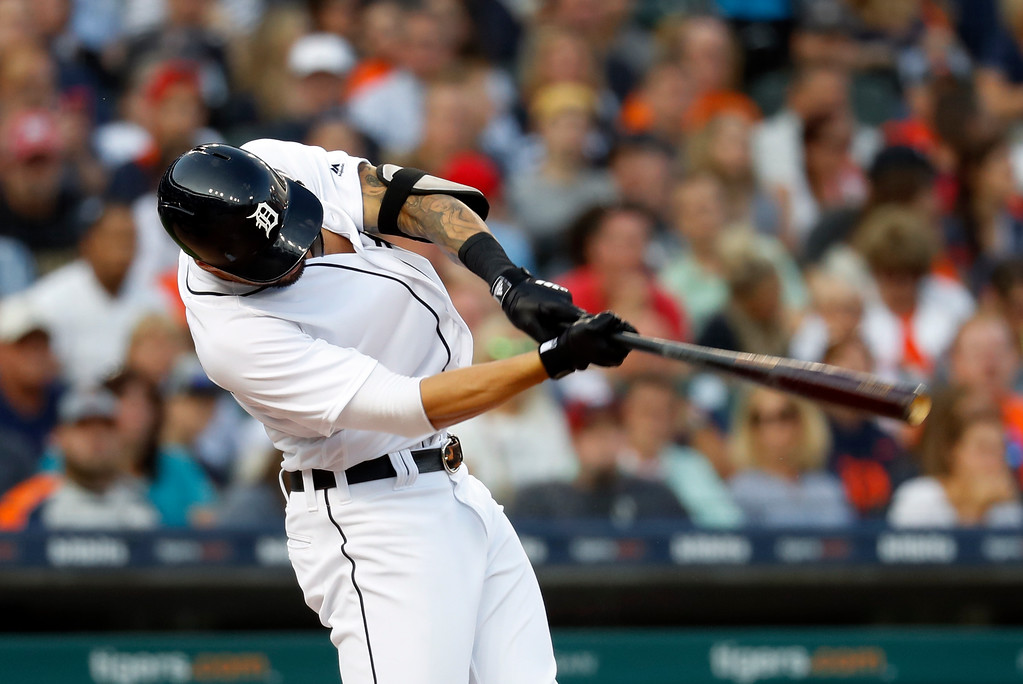 . Detroit Tigers\' Nicholas Castellanos hits a one-run double in the third inning of a baseball game in Detroit, Friday, July 27, 2018. (AP Photo/Paul Sancya)