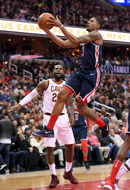 . Washington Wizards guard Bradley Beal (3) goes to the basket against Cleveland Cavaliers forward LeBron James (23) during the second half of an NBA basketball game, Sunday, Dec. 17, 2017, in Washington. (AP Photo/Nick Wass)