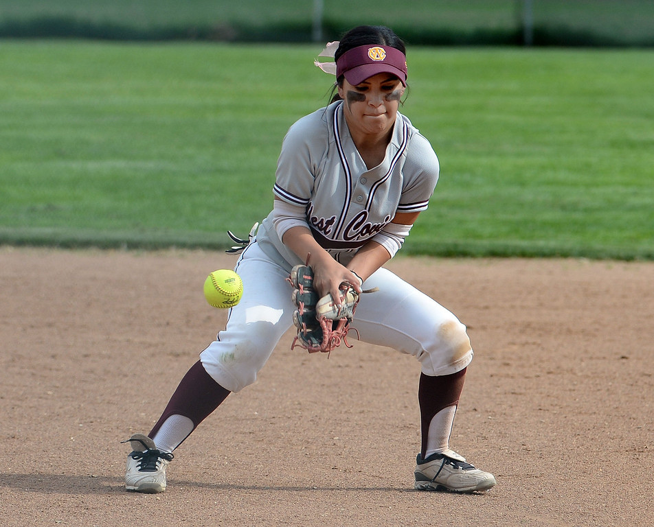. West Covina shortstop Nadiya Lozano (C) (15) commits an error on a ground ball by Bonita\'s Vienna Benavides (not pictured) in the first inning of a prep softball game at Los Flores Park in La Verne, Calif., on Thursday, March 27, 2014. Bonita won 6-3. (Keith Birmingham Pasadena Star-News)