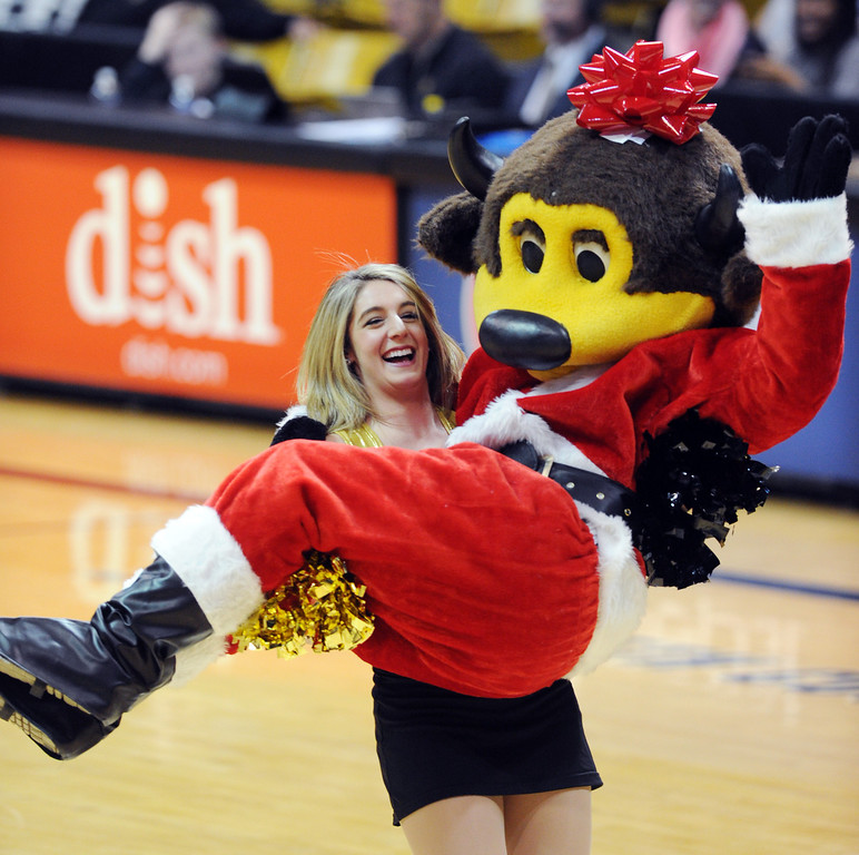 . CU cheerleaders have the strength to carry Chip around during the first half of the December 13, 2013 game in Boulder. (Cliff Grassmick/Boulder Daily Camera)