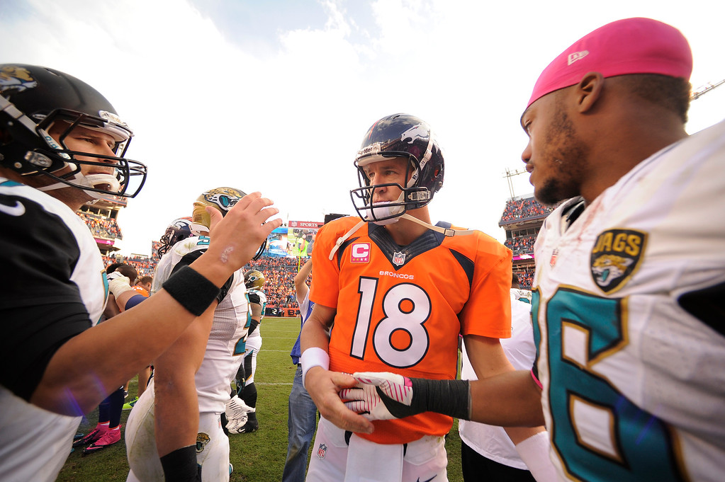 . Denver Broncos quarterback Peyton Manning (18) shakes hands with Jaguar players after the game. The Denver Broncos take on the Jacksonville Jaguars at Sports Authority Field at Mile High in Denver on October 13, 2013. (Photo by John Leyba/The Denver Post)