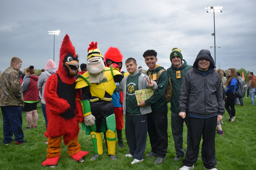 . Briana Contreras � The Morning Journal <br> Students of Amherst City Schools and Comet Man hang out with the Brookside Cardinals mascots of Sheffield/Sheffield Lake at the 38th Annual Lorain County Special Olympics Track and Field Event held on May 11 at Ely Stadium in Elyria.