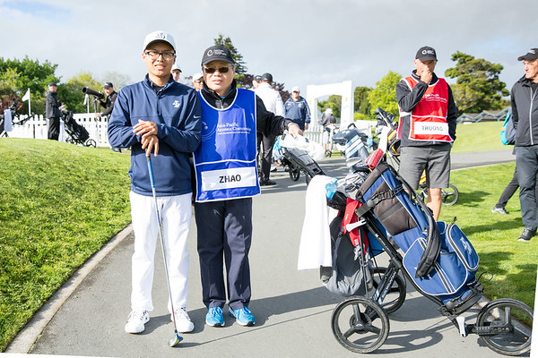 Nathan Zhao from Guam with his caddy after hitting off the 1st tee on Day 1 of competition in the Asia-Pacific Amateur Championship tournament 2017 held at Royal Wellington Golf Club, in Heretaunga, Upper Hutt, New Zealand from 26 - 29 October 2017. Copyright John Mathews 2017.   www.megasportmedia.co.nz