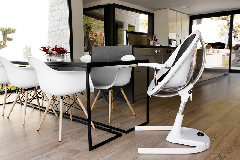 Mima_Moon_Lifestyle_White_Highchair_At_Table_Height_Side_View_In_Kitchen_Setting.jpg
