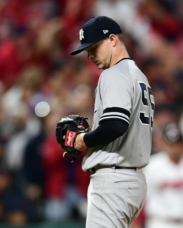 . New York Yankees starting pitcher Sonny Gray hangs his head after Cleveland Indians\' Jay Bruce hit a two-run home run in the fourth inning of Game 1 of baseball\'s American League Division Series, Thursday, Oct. 5, 2017, in Cleveland. Edwin Encarnacion scored on the play. (AP Photo/David Dermer)