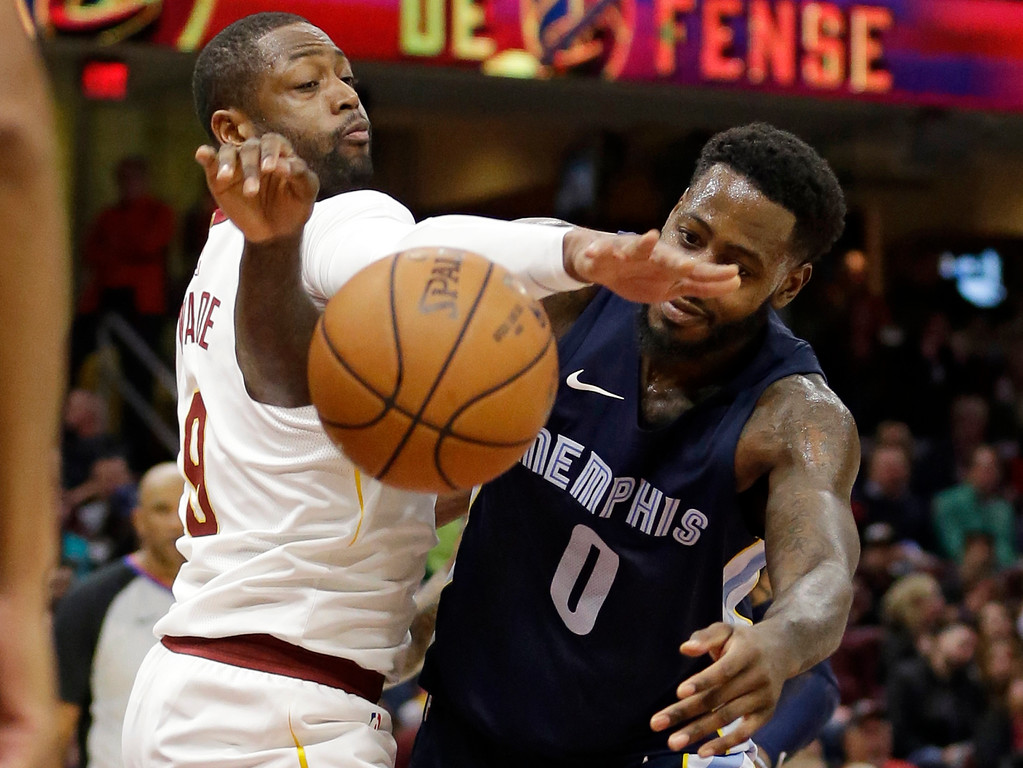 . Cleveland Cavaliers\' Dwyane Wade, left, knocks the ball loose from Memphis Grizzlies\' JaMychal Green in the second half of an NBA basketball game, Saturday, Dec. 2, 2017, in Cleveland. (AP Photo/Tony Dejak)