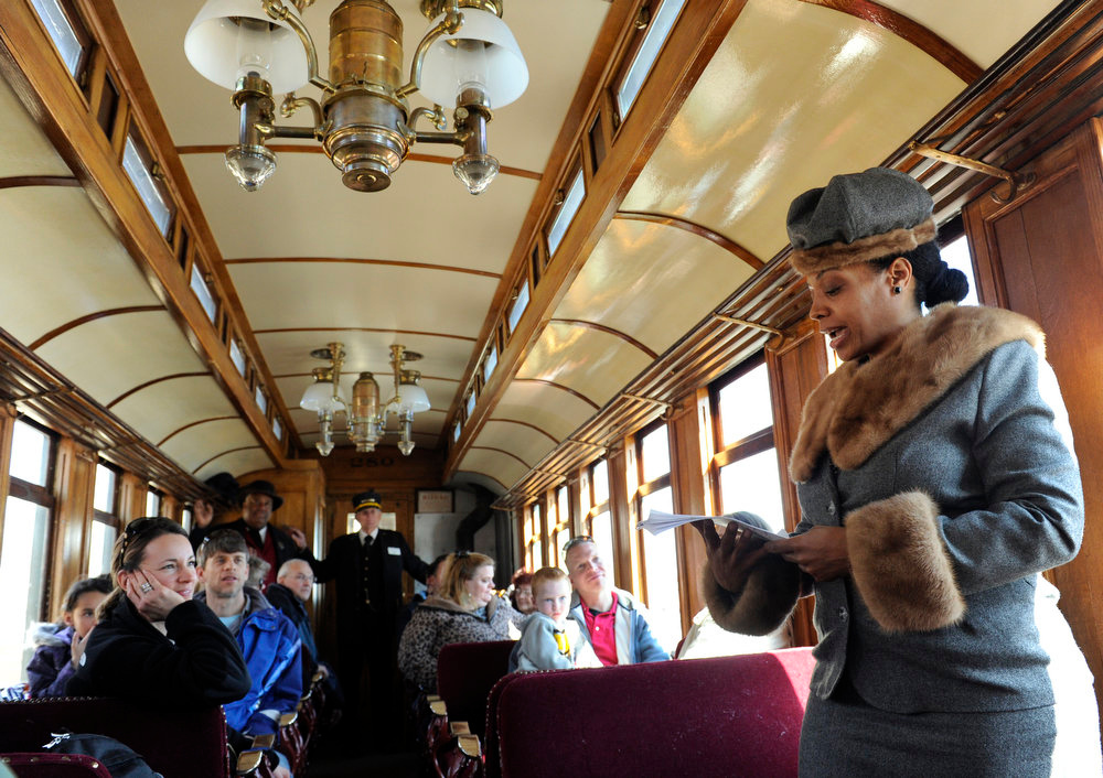 Description of . Deanna Lowman, right, plays the part of Sarah Elizabeth Lowman on board an 1880's narrow gage passenger coach as the Colorado Railroad Museum in Golden hosts a Black History Month event, Black on Track: African American Connections and Stories. Members of the James P. Beckworth Mountain Club, historical reenactors from Denver, gave visitors an experience of the African American connections and stories that contributed to both the railroad and cultural history of Colorado. Kathryn Scott Osler, The Denver Post