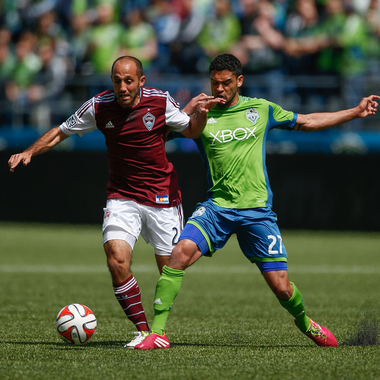 . Lamar Neagle #27 of the Seattle Sounders FC dribbles against Nick LaBrocca #2 of the Colorado Rapids at CenturyLink Field on April 26, 2014 in Seattle, Washington. (Photo by Otto Greule Jr/Getty Images)