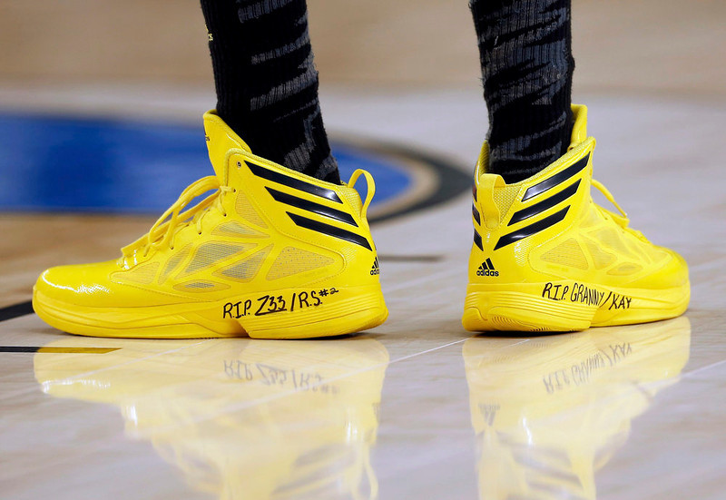 . The shoes of Michigan Wolverines guard Tim Hardaway Jr. are seen on the court in the game against the Florida Gators in their South Regional NCAA men\'s basketball game in Arlington, Texas March 31, 2013. REUTERS/Jim Young