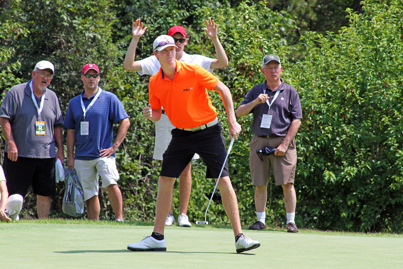 Jordan Niebrugge of Mequon, WI celebrates with a fist pump after draining a 50-foot birdie putt during the semifinals of the 111th Western Amateur at The Alotian Club in Roland, AR. (WGA Photo/Ian Yelton)