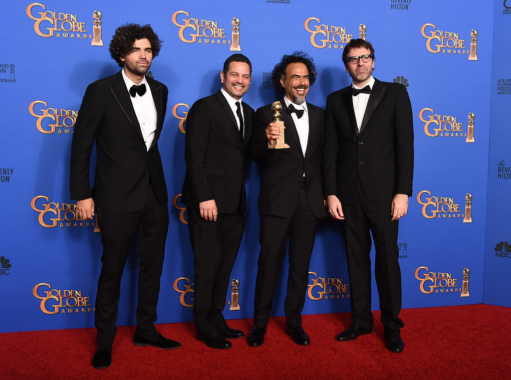 . Armando Bo, from left, Alexander Dinelaris Jr., Alejandro Gonzalez Inarritu and Nicolas Giacobone pose in the press room with the award for best screenplay for �Birdman� at the 72nd annual Golden Globe Awards at the Beverly Hilton Hotel on Sunday, Jan. 11, 2015, in Beverly Hills, Calif. (Photo by Jordan Strauss/Invision/AP)