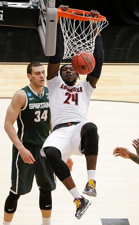 . Louisville\'s Montrezl Harrell (24) dunks the ball in front of Michigan State\'s Gavin Schilling (34) during the first half of a regional final in the NCAA men\'s college basketball tournament Sunday, March 29, 2015, in Syracuse, N.Y. (AP Photo/Frank Franklin II)