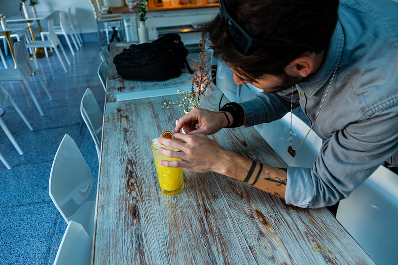 Zander Maslow, bar manager at Sassafras, puts the finishing touches on a Florida sun tea on Friday, November 22, 2019. Sassafras is located at 105 S Narcissus Ave., West Palm Beach, FL,. [JOSEPH FORZANO/palmbeachpost.com]
