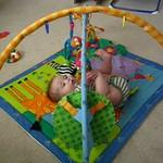 Baby Quinn playin on mat 1