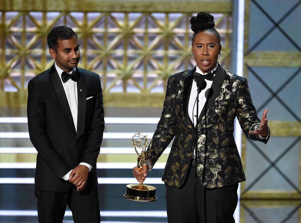 """. Aziz Ansari, left, and Lena Waithe accept the award for outstanding writing for a comedy series for the \""""Master of None\"""" episode \""""Thanksgiving\"""" at the 69th Primetime Emmy Awards on Sunday, Sept. 17, 2017, at the Microsoft Theater in Los Angeles. (Photo by Chris Pizzello/Invision/AP)"""