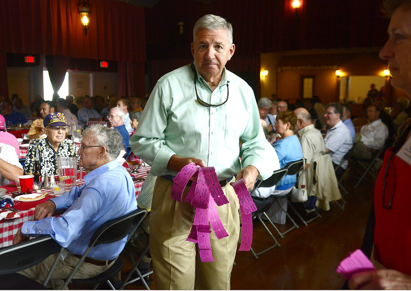 9/5/2014 Mike Orazzi   Staff John Lodovico sells 50-50 tickets during the annual Crocodile Club dinner at Lake Compounce Friday afternoon.