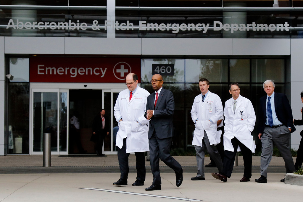 . Ohio State University president Michael Drake, second from left, and Dr. Andrew Thomas, chief medical officer at the Wexner Medical Center, walk toward a press briefing following an attack on campus on Monday, Nov. 28, 2016 outside the Ohio State University Wexner Medical Center in Columbus, Ohio. Nine people were hospitalized after a man ran into pedestrians with his car then exited his vehicle and began cutting victims with a butcher knife. (Joshua A. Bickel/The Columbus Dispatch) /The Columbus Dispatch via AP)