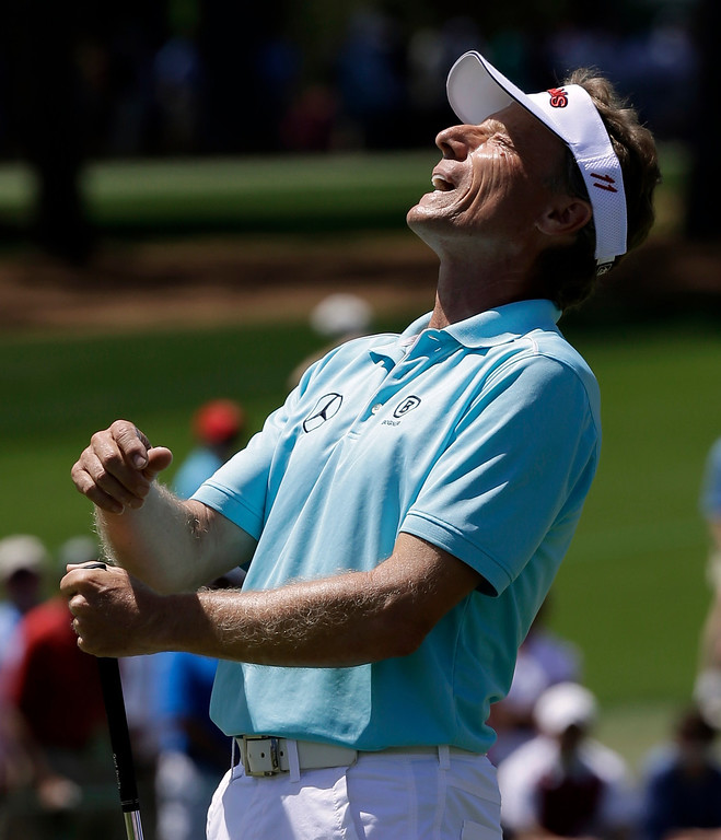 . Bernhard Langer, of Germany, reacts after missing a putt on the second green during the third round of the Masters golf tournament Saturday, April 13, 2013, in Augusta, Ga. (AP Photo/David J. Phillip)