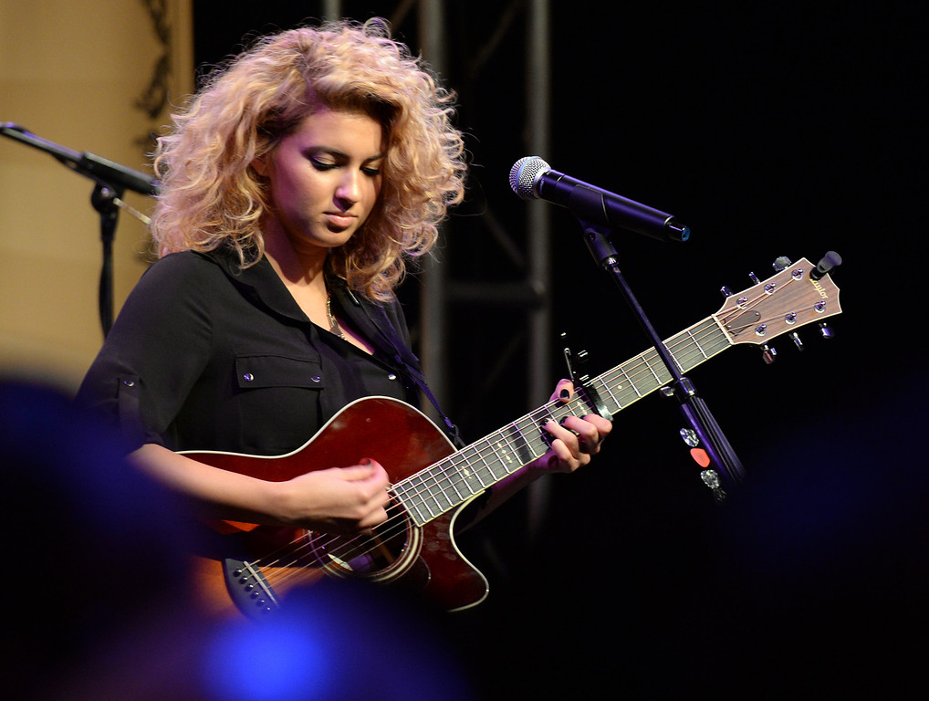 . New pop singer Tori Kelly performs in the Taylor Guitars booth during The NAMM (National Association of Music Merchants) Show, the world wide music trade show, at the Anaheim Convention Center in Anaheim on Friday January 24, 2014. NAMM is a music trade show drawing retailers and other industry people to Anaheim for four days of everything music. (Staff Photo by Keith Durflinger/San Gabriel Valley Tribune)