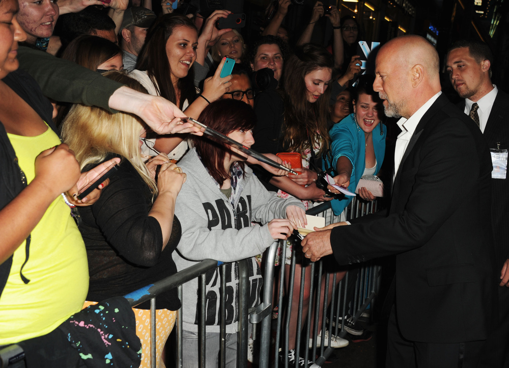 ". Actor Bruce Willis attends the premiere of Paramount Pictures\' ""G.I. Joe:Retaliation\"" at TCL Chinese Theatre on March 28, 2013 in Hollywood, California.  (Photo by Kevin Winter/Getty Images)"