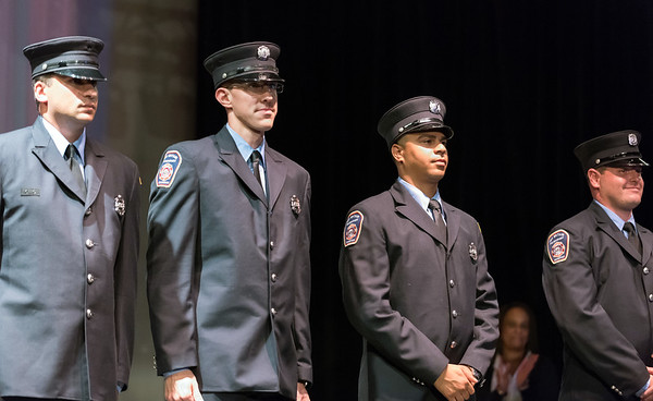 09/20/18 Wesley Bunnell | Staff The New Britain Fire Department held their 2018 Awards Ceremony on Thursday September 20 at Trinity on Main. Firefighters stand on stage after the badge pinning ceremony including Alexander Ugarte, 3rd from L.