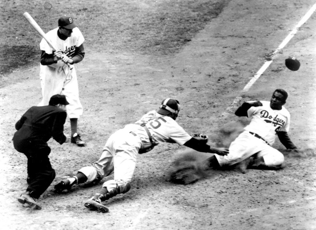 . Jackie Robinson, shown stealing home against the Chicago Cubs in 1952.  (Los Angeles Daily News file photo)