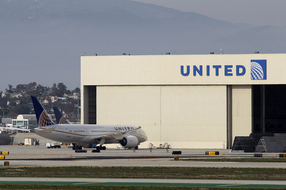 Description of . A Boeing 787 Dreamliner operated by United Airlines is parked near a United hanger at Los Angeles International Airport (LAX) on January 9, 2013 in Los Angeles, California. Two separate 787 jets operated by Japan Airlines (JAL) experienced mechanical problems in Boston this week. A fuel leak during takeoff forced one to return to the terminal the day after a fire erupted aboard a different Dreamliner parked at a gate shortly after landing.  (Photo by David McNew/Getty Images)