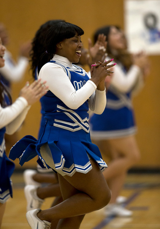 . Oakland High School cheerleaders entertain the crowd during a timeout in the third quarter of an Oakland Athletic League semi-final tournament game, Tuesday, Feb. 26, 2013 in Oakland, Calif. (D. Ross Cameron/Staff)