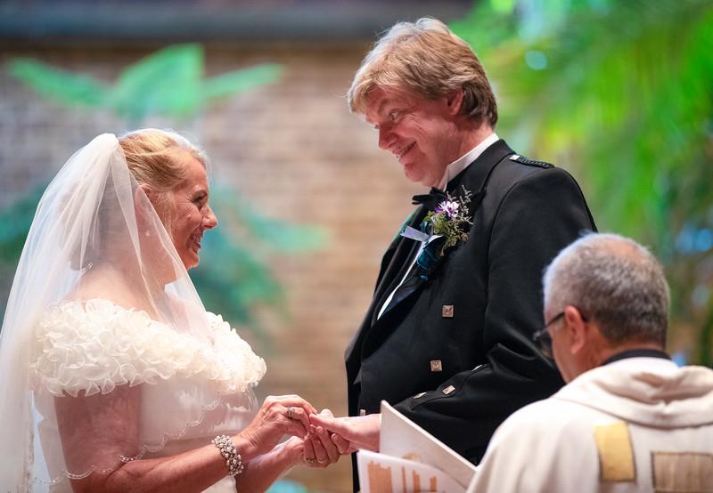 Bride Putting Ring on Groom.jpg