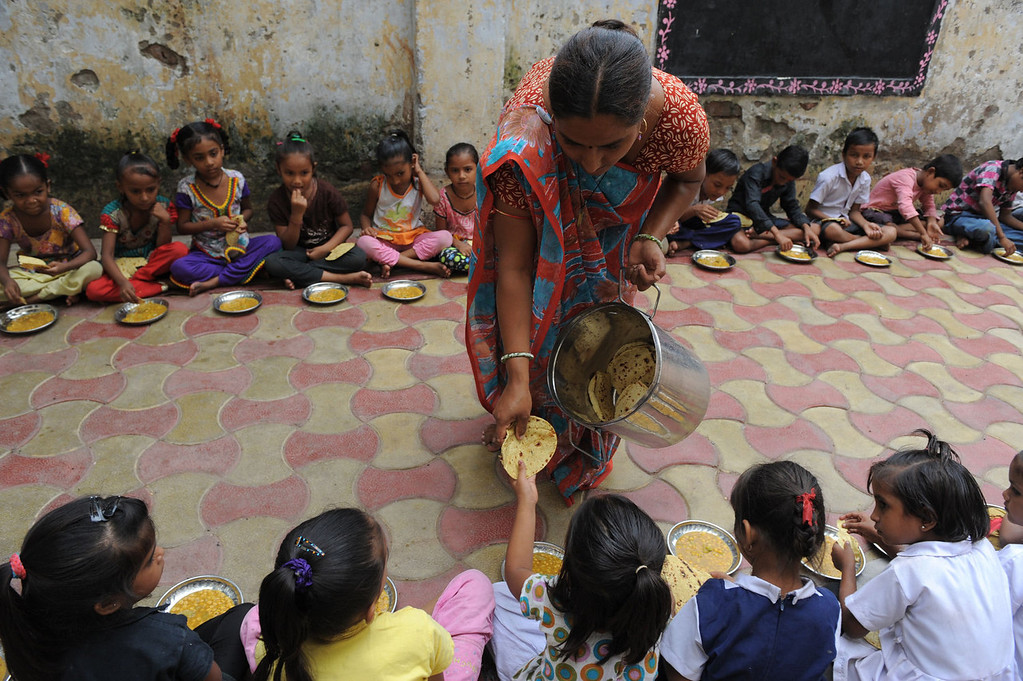 . Indian schoolchildren at Jahangirpura Shala Number 2, which is run by the Ahmedabad Municipal Corporation, are served their free mid-day meal in Ahmedabad on July 17, 2013. Twenty-two children have died in India\'s Bihar state after eating a free lunch feared to contain poisonous chemicals at an Indian primary school, officials said July 17, as the tragedy sparked angry street protests.  SAM PANTHAKY/AFP/Getty Images
