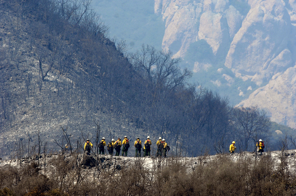 . A hand crew walks to cut a line around the smoldering Springs Fire in Hidden Valley, Saturday, May 4, 2013. (Michael Owen Baker/Staff Photographer)