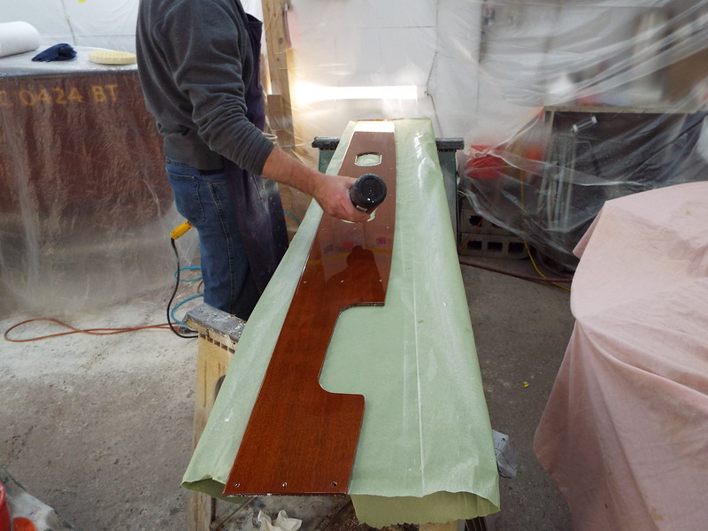 Buffing the cockpit liner.