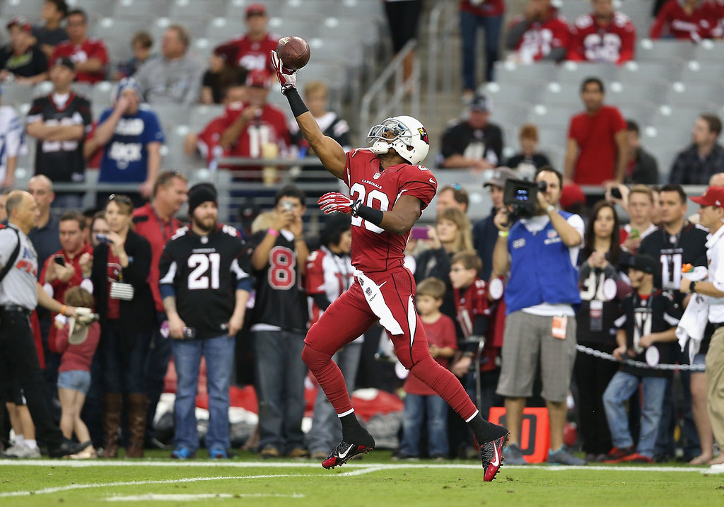 . Cornerback Antoine Cason #20 of the Arizona Cardinals catches a pass as he warms up before the NFL game against the Indianapolis Colts at the University of Phoenix Stadium on November 24, 2013 in Glendale, Arizona.  (Photo by Christian Petersen/Getty Images)