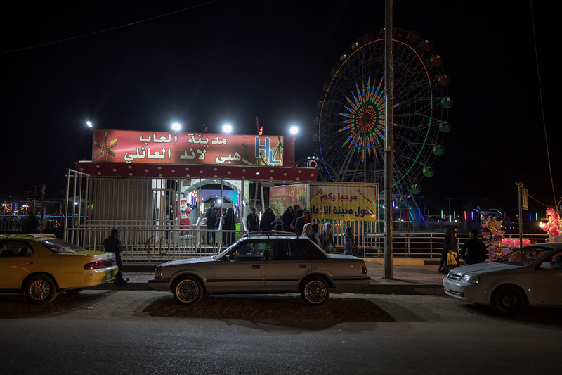 A family leaving the colourful Basra fairground.
