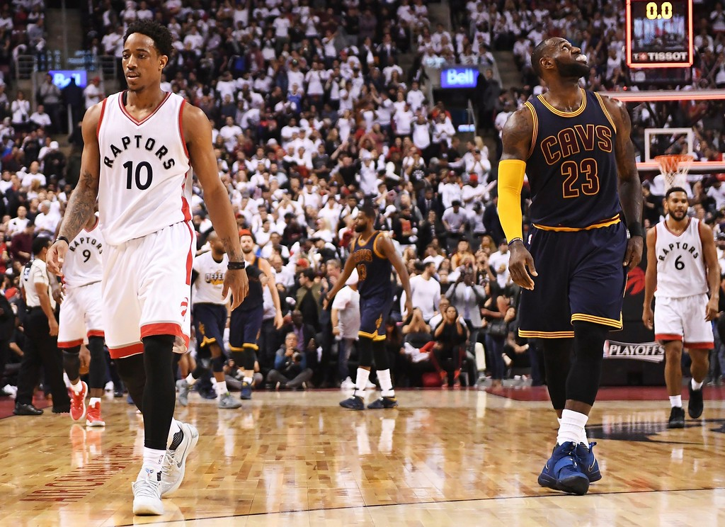 . Toronto Raptors guard DeMar DeRozan (10) and Cleveland Cavaliers forward LeBron James (23) walk off the court after the first half of Game 3 of an NBA basketball second-round playoff series in Toronto on Friday, May 5, 2017. (Frank Gunn/The Canadian Press via AP)