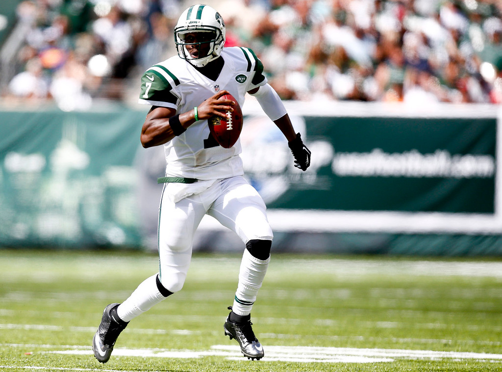 . Geno Smith #7 of the New York Jets runs the ball against the Tampa Bay Buccaneers during their game at MetLife Stadium on September 8, 2013 in East Rutherford, New Jersey.  (Photo by Jeff Zelevansky/Getty Images)