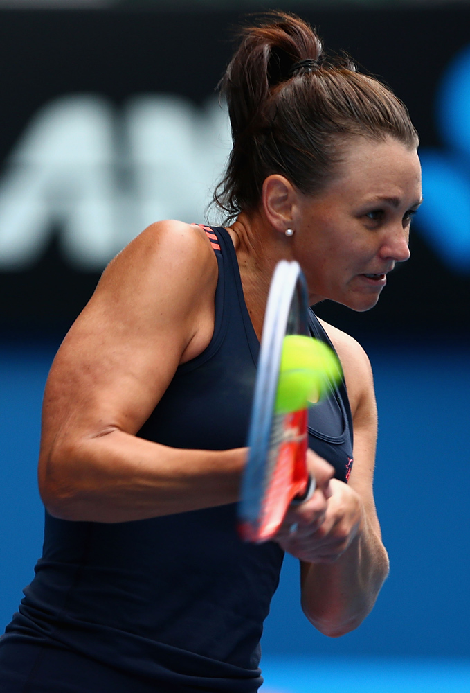Description of . Casey Dellacqua of Australia plays a backhand in her doubles final match with Ashleigh Barty of Australia against Sara Errani and Roberta Vinci of Italy during day twelve of the 2013 Australian Open at Melbourne Park on January 25, 2013 in Melbourne, Australia.  (Photo by Mark Kolbe/Getty Images)
