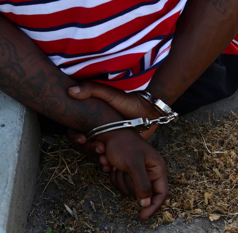 . An unidentified man is arrested because of a probation violation along the 1200 block of N. Genevieve Street in San Bernardino April 4, 2013.   GABRIEL LUIS ACOSTA/STAFF PHOTOGRAPHER.