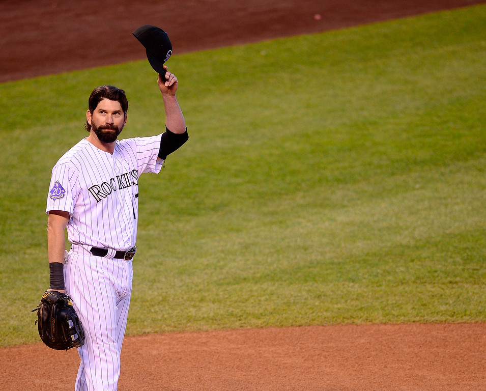 . Todd Helton tips his cap to the crowd before the start of his final home game at Coors Field on Wednesday. (Photo by AAron Ontiveroz/The Denver Post)