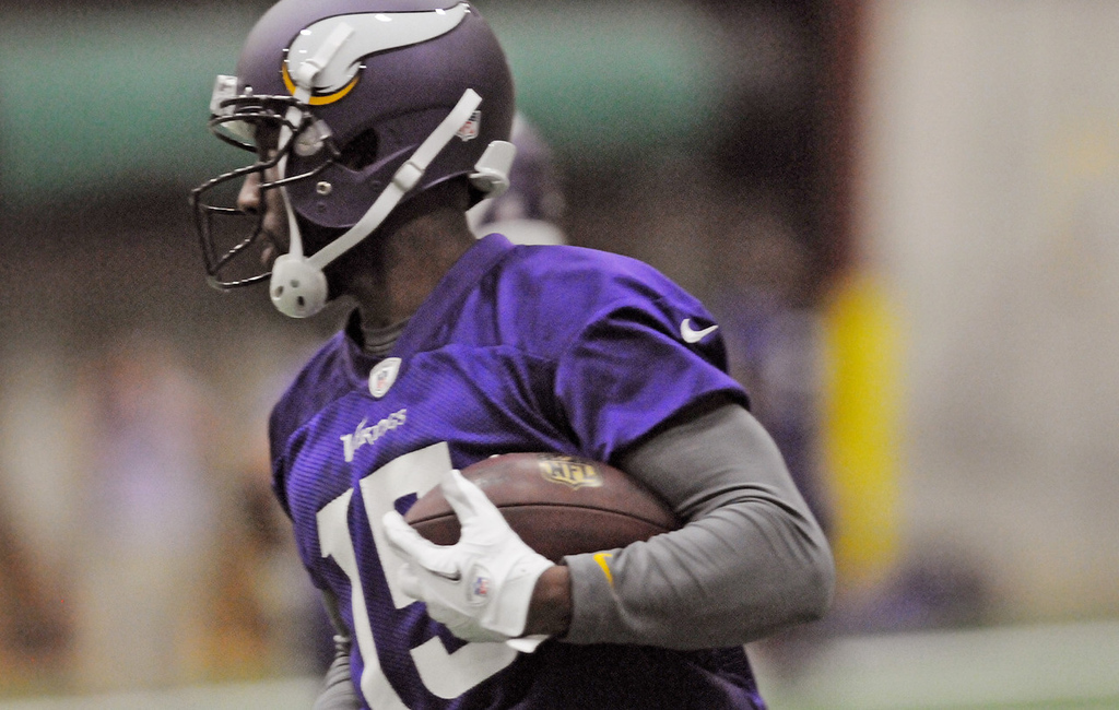 . Vikings wide receiver Greg Jennings makes a reception and runs with the ball during practice. (Pioneer Press: Jean Pieri)