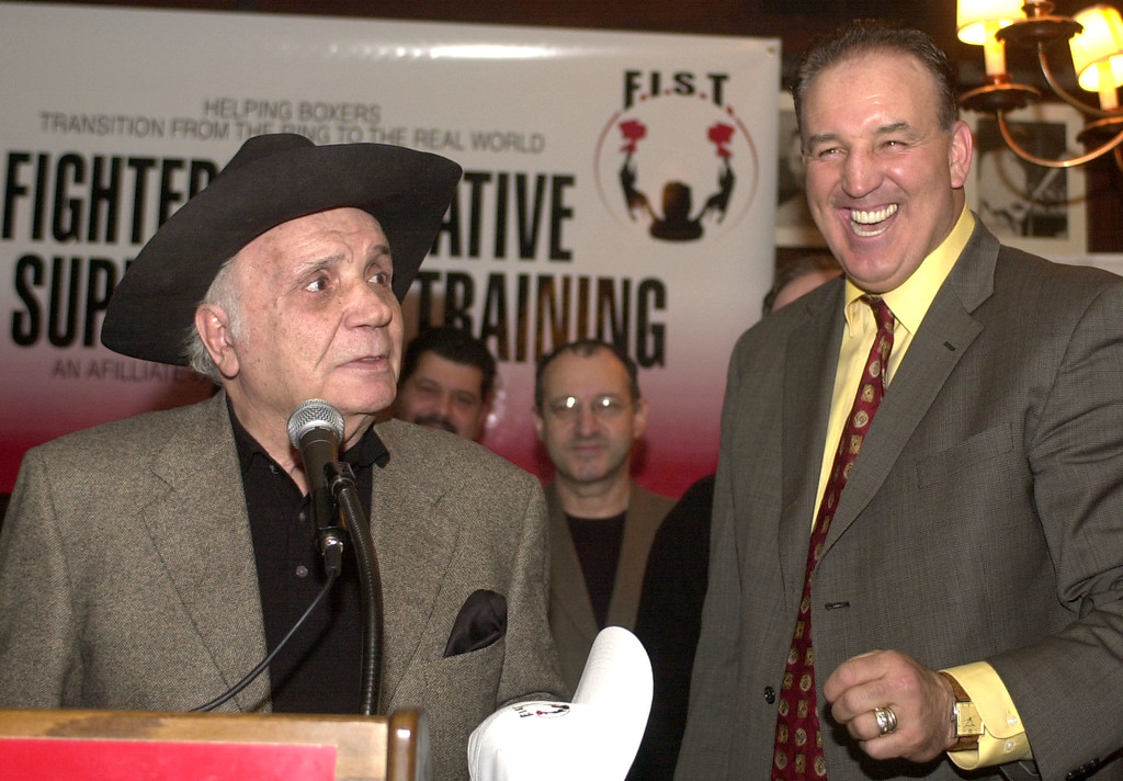 . Gerry Cooney, right, former heavyweight contender and F.I.S.T. founder and chairman laughs as Jake LaMotta, former world middleweight champion tells a joke about him at a news conference in New York, Tuesday, March 11, 2003. Cooney announced the formation of the Boxers Guild by F.I.S.T., the Fighters\' Initiative For Support And Training, OPEIU, Local 153 and the AFL-CIO. (AP Photo/Ed Bailey)